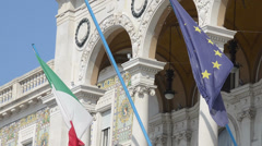 EU and Italian flags - stock footage