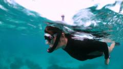 Woman snorkelling in aqua blue water Stock Footage