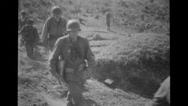 Military soldiers and photographers walking across fields Stock Footage