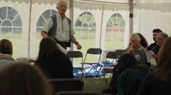Festival meeting conference speaker older man Stock Footage