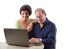 East indian elderly couple on computer Stock Photos