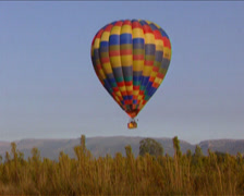 Slight low angled long shot of a hot air balloon ride Stock Footage