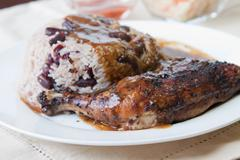 jerk chicken with rice - caribbean style - stock photo