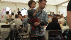 People and families-dining tent at a festival Stock Footage