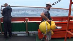 Scientist preparing the SMOS buoy manouver Stock Footage
