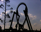 Stock Video Footage of A roller-coaster track loop as the roller-coaster cart loops round the track
