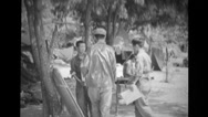 Soldiers and the prisoner walking towards the table Stock Footage