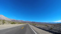 POV road trip Death Valley hot dry landscape vehicle motion extreme terrain USA - stock footage