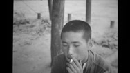 Prisoner of war smoking a cigarette Stock Footage