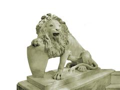 Lion with a shield statue Stock Photos