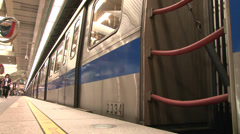 Train leaving the train station. Camera at the floor level filming the traffic Stock Footage