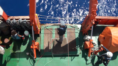 Worker ascending radiometer to the ship Stock Footage