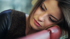 Sad beautiful woman looking to the camera, close-up Stock Footage