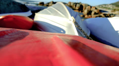 Boats pulled up on the beach - stock footage