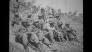 Military troops sitting and having meal Stock Footage