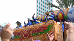 Krewe throwing out beads in parade slow motion part 2 Stock Footage