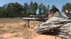 Sniper firing down a range during training Stock Footage