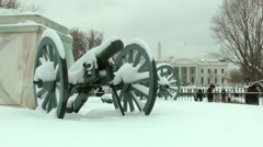 White House, snow, cannons in park; tourists. Stock Footage