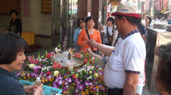 Pouring holy water on Buddha in the Shilin Night Market in Danshui Stock Footage