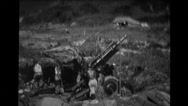Military soldiers loading and firing howitzer Stock Footage