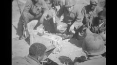 Soldiers listening to gramophone - free stock footage