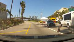 POV Car Entering LAX Airport Past Signs And Security- Los Angeles CA Stock Footage