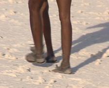 Bushmen armed with bow in the Kalahari desert Stock Footage