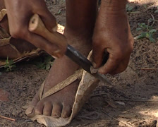 Tribal shoe making Stock Footage