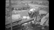 Military soldiers cleaning barrel of howitzer Stock Footage