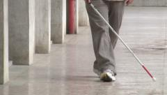 Blind man walking with his white cane for the street Stock Footage
