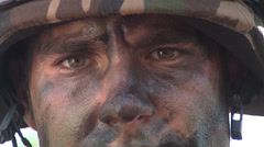 Soldier with camouflage paint face Stock Footage