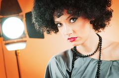 Young attractive girl with afro curly haircut - stock photo