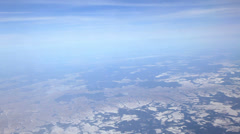 Flying over ice fields, snowy landscape. View from plane side window Stock Footage