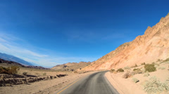 POV road trip Death Valley hot dry landscape colour vehicle motion USA Stock Footage