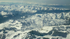 Aerial tracking shot of snow covered Alps 6/7 -0011 Stock Footage