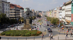 Wenceslas Square with people and passing cars - timelapse - buildings and nature Stock Footage