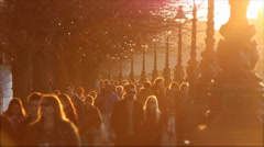 People walking in city sunset. Stock Footage