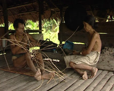 Mentawai making a basket Stock Footage