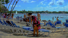 People on Tropical Beach - Vintage Look Stock Footage