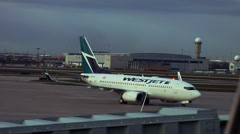 Canadian Airplane - Westjet on the Tarmac - stock footage