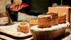 Trdelník (chimney cake or stove cake) in shop (in night) Stock Footage