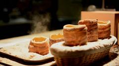 Trdelnik (chimney cake or stove cake) in shop (in night) Stock Footage