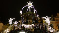 PRAGUE, CZECH REPUBLIC - DECEMBER 2013: Christmas shining bridge with people Stock Footage