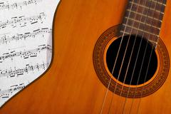 Classical guitar and notes Stock Photos