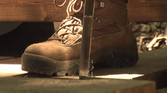 Person sawing in boots Stock Footage