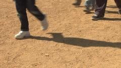 People walking in dirt Stock Footage
