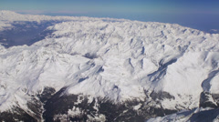 Aerial tracking shot of snow covered Alps 5/7 -0010 Stock Footage