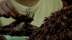 Street market in Cambodia. Selling insects as snack Stock Footage
