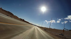 POV driving road trip American Freeway sun flare Nevada USA Stock Footage
