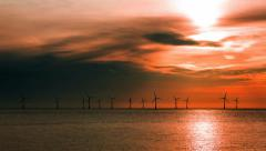 Stock Video Footage of Offshore wind turbines producing renewable energy in the UK timelapse HD